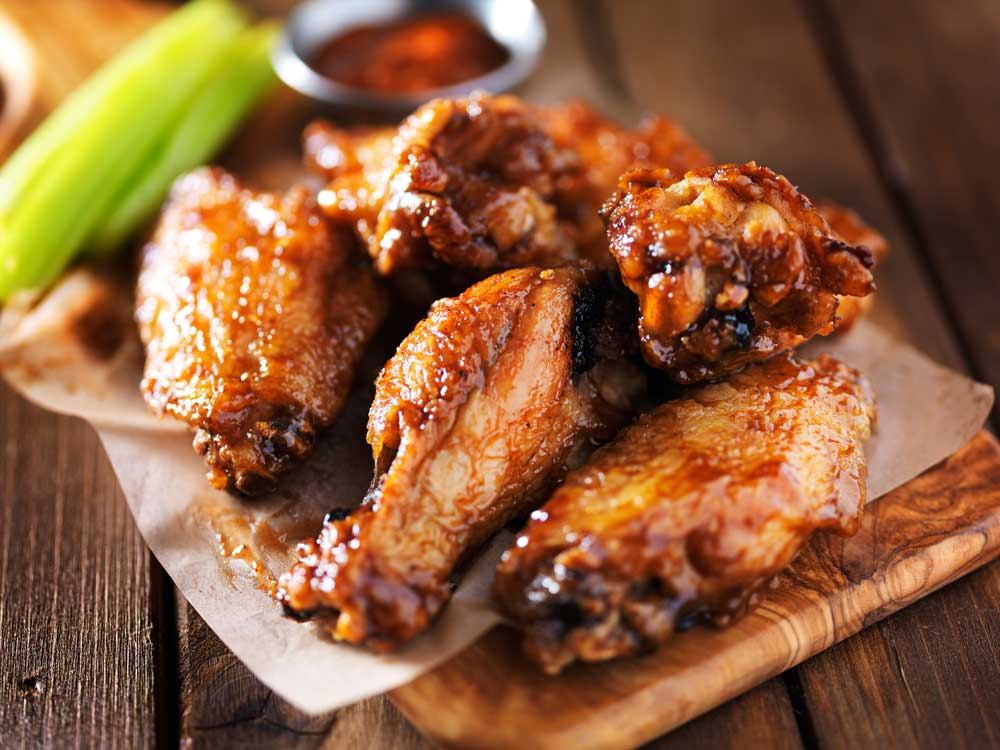 Close up of glazed chicken wings