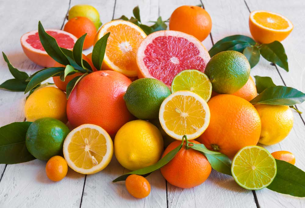 Pile of citrus on a wooden table