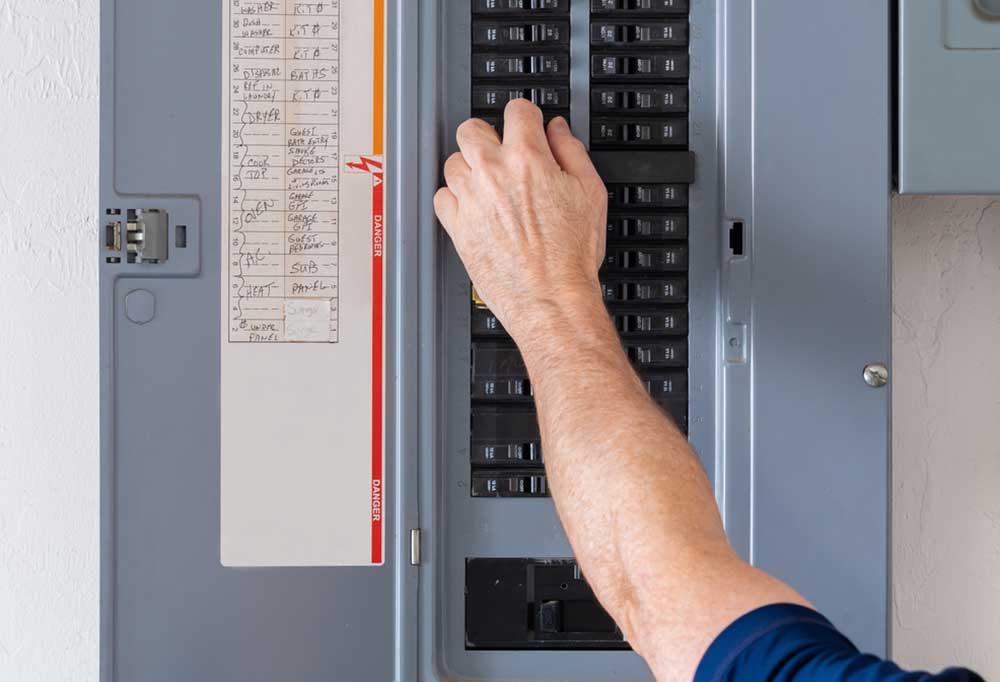 Hand resetting a breaker panel