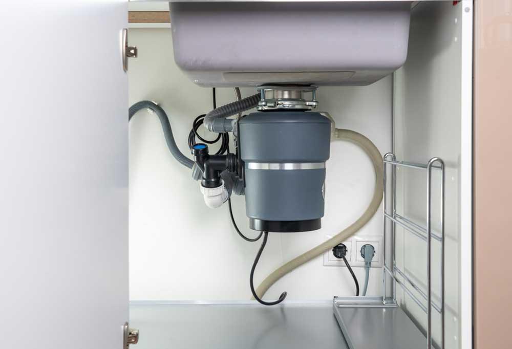 View of garbage disposal under sink