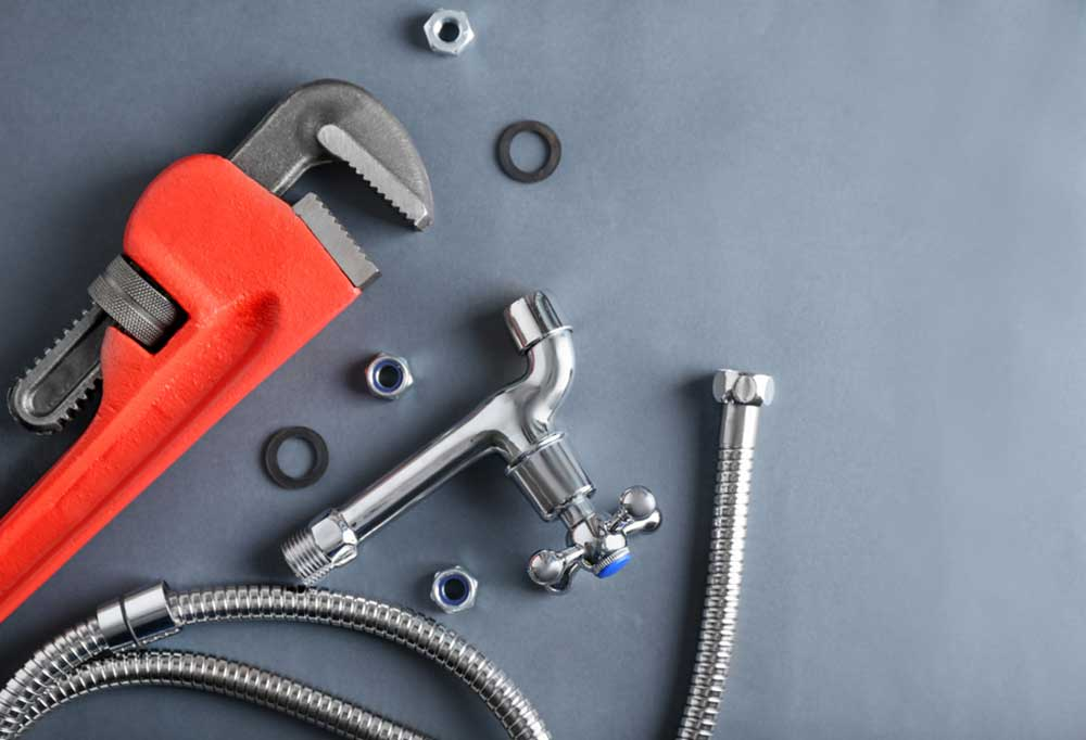 plumbers tools on a grey background