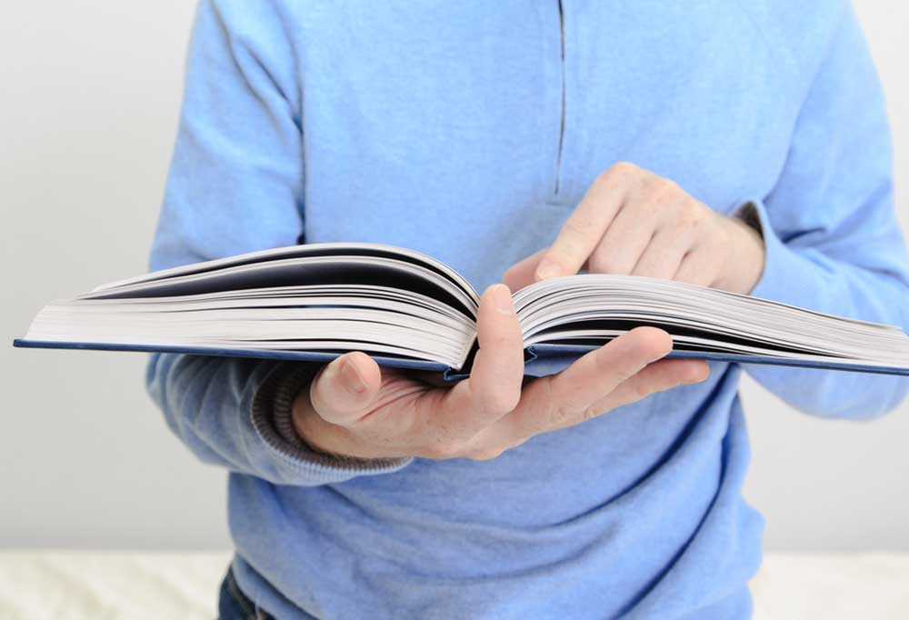 Closeup of person holding an open manual
