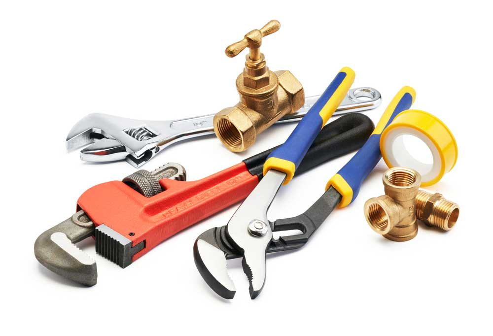 plumbers tools on white background