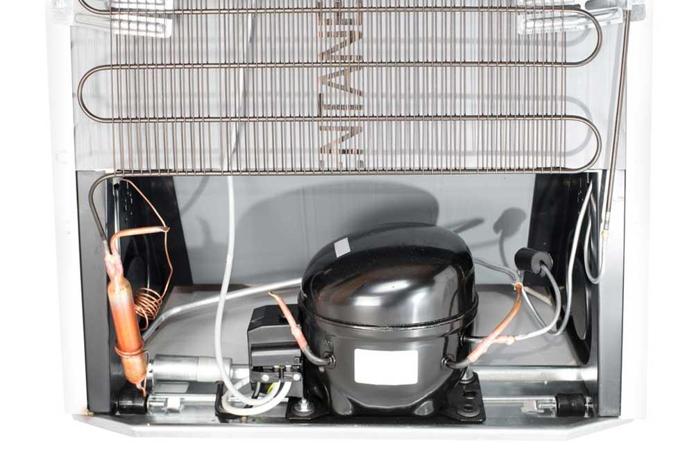back view of a refrigerator including compressor and coils