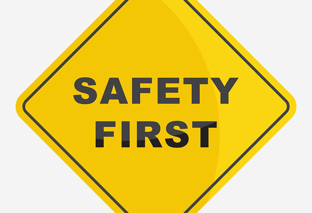 Bright yellow sign that reads Safety First