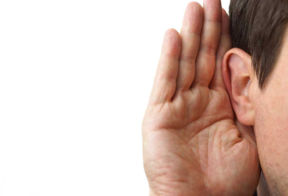 Hand being cupped to ear as if to listen