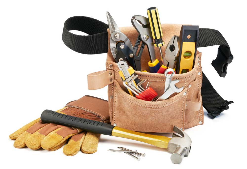 Bag of tools , gloves and a hammer on a white background