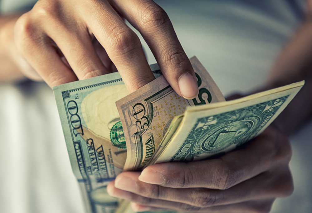 Closeup of hands counting US dollars