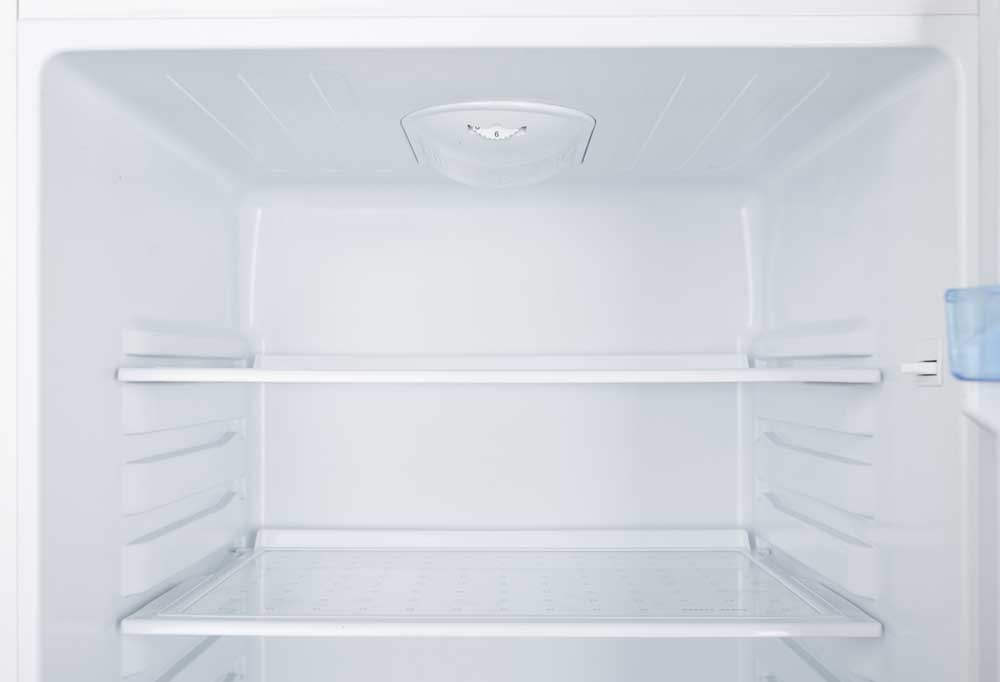 The inside of a new, clean, and empty fridge