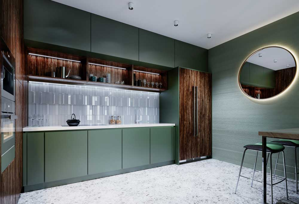 Modern kitchen in sage green with dark wood panel on fridge doors