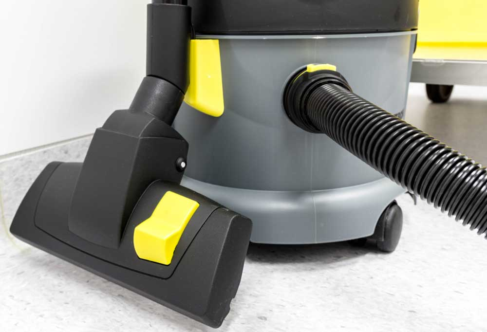 Close up of a grey, black, and yellow  wet/ dry shop vacuum cleaner