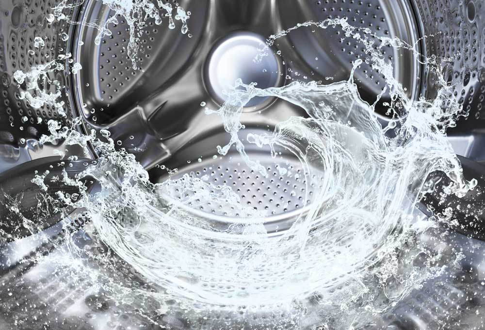 Inside view of a washing machine with water