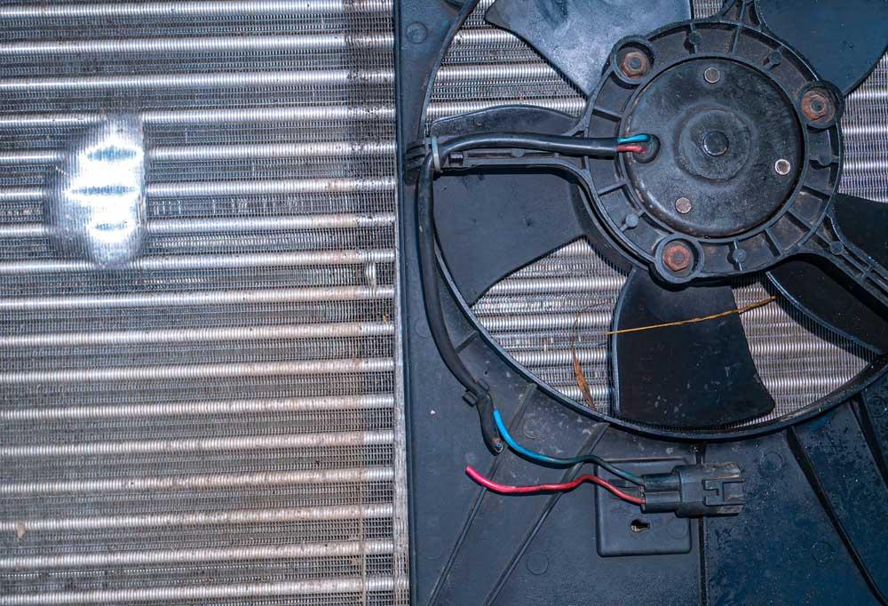 Evaporator Fan leaning against condenser coils