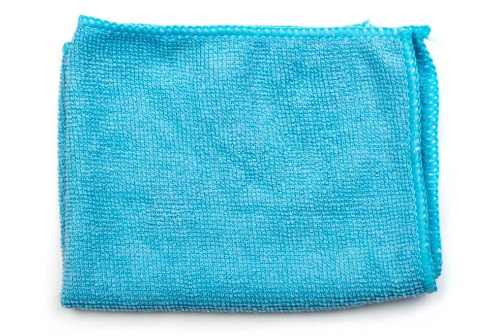 Blue terrycloth rag on a white background