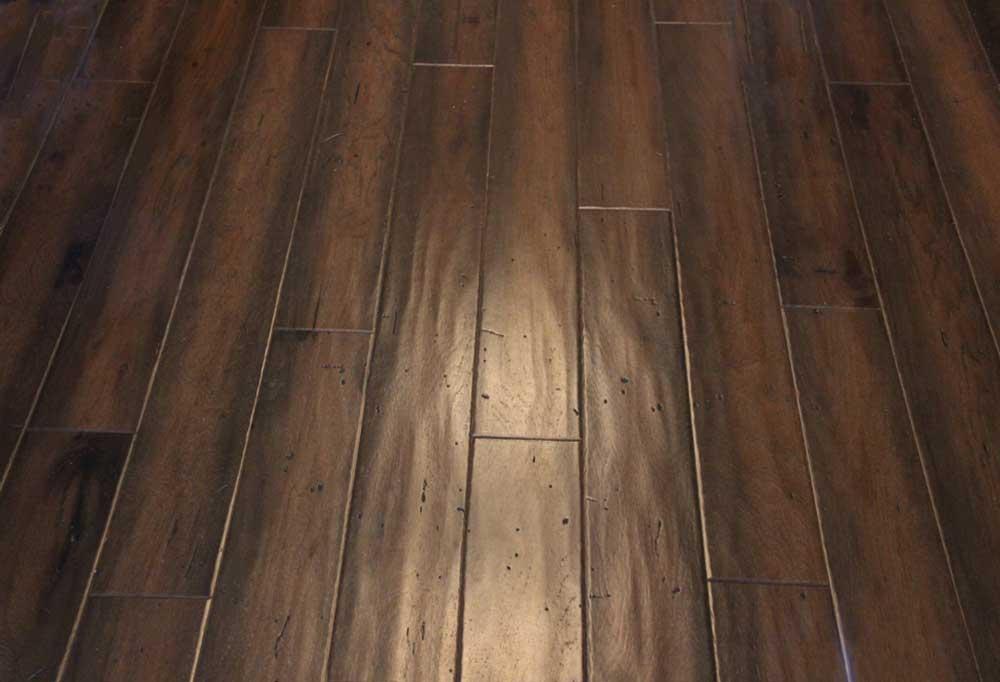 Dark hardwood floor with a cloudy finish.