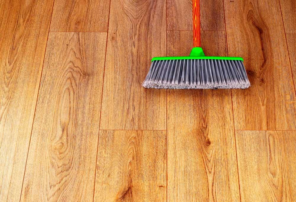 Broom laying down on hardwood floor