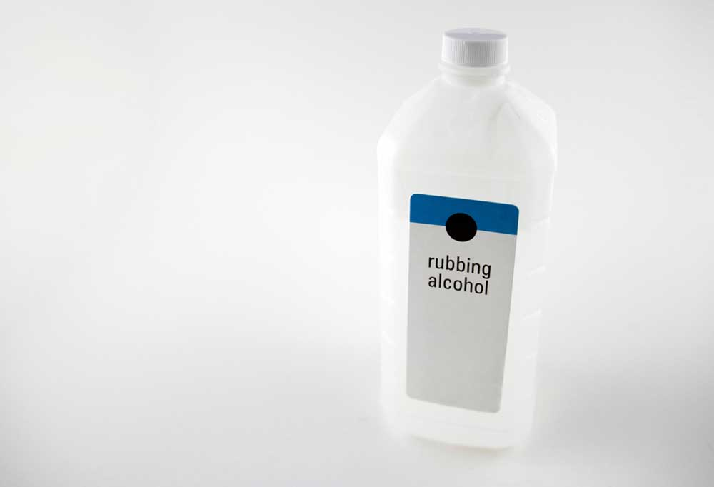 Bottle of rubbing alcohol isolated on a grey background